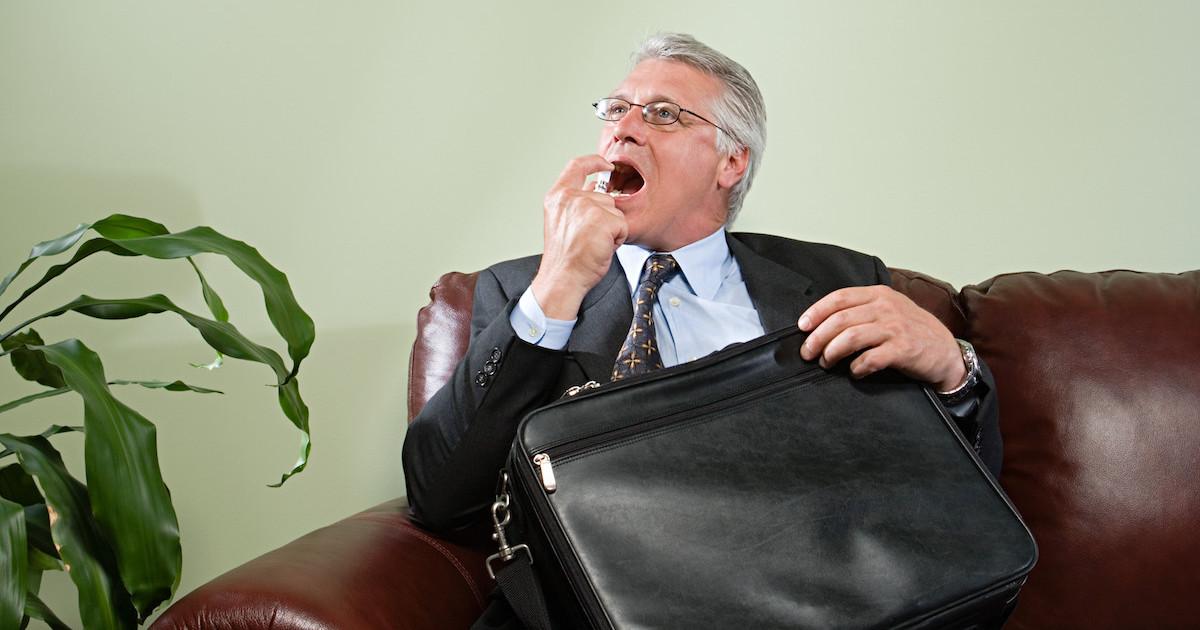 Man using breath freshener